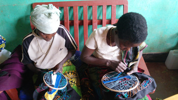Two of Kibeho Project women busy embroidering.