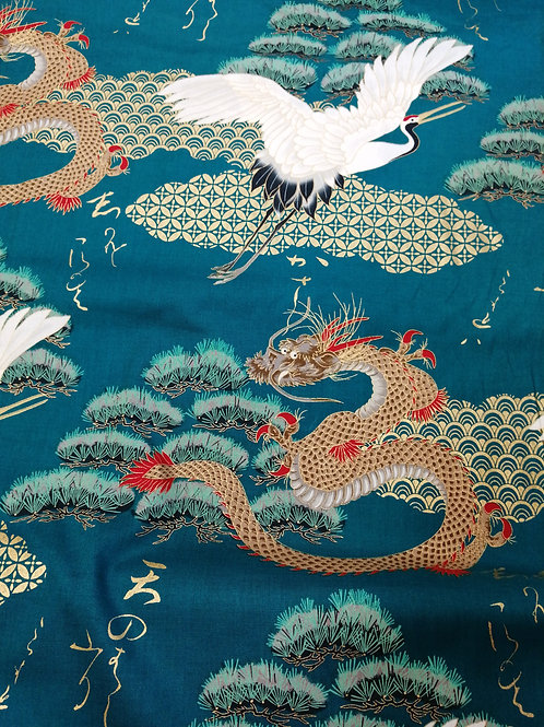 Japanese Cotton crane and golden dragon design with a teal background