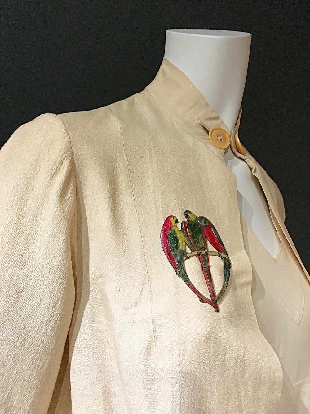 1920's silk blouson jacket with enamelled parrot brooch