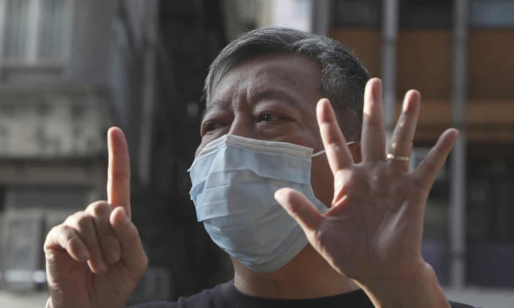 Hong Kong pro-democracy activist Lee Cheuk-Yan gives the 'five demands, not one less' hand sign. Zoom has admitted it disrupted activists' meetings at the behest of the Chinese government. Photograph: Kin Cheung/AP
