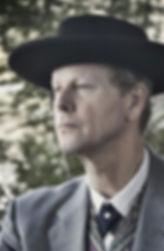 Alan Campbell as Frank Lloyd Wright