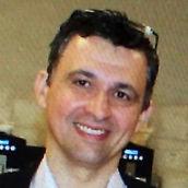 Dr Adrian Coman
