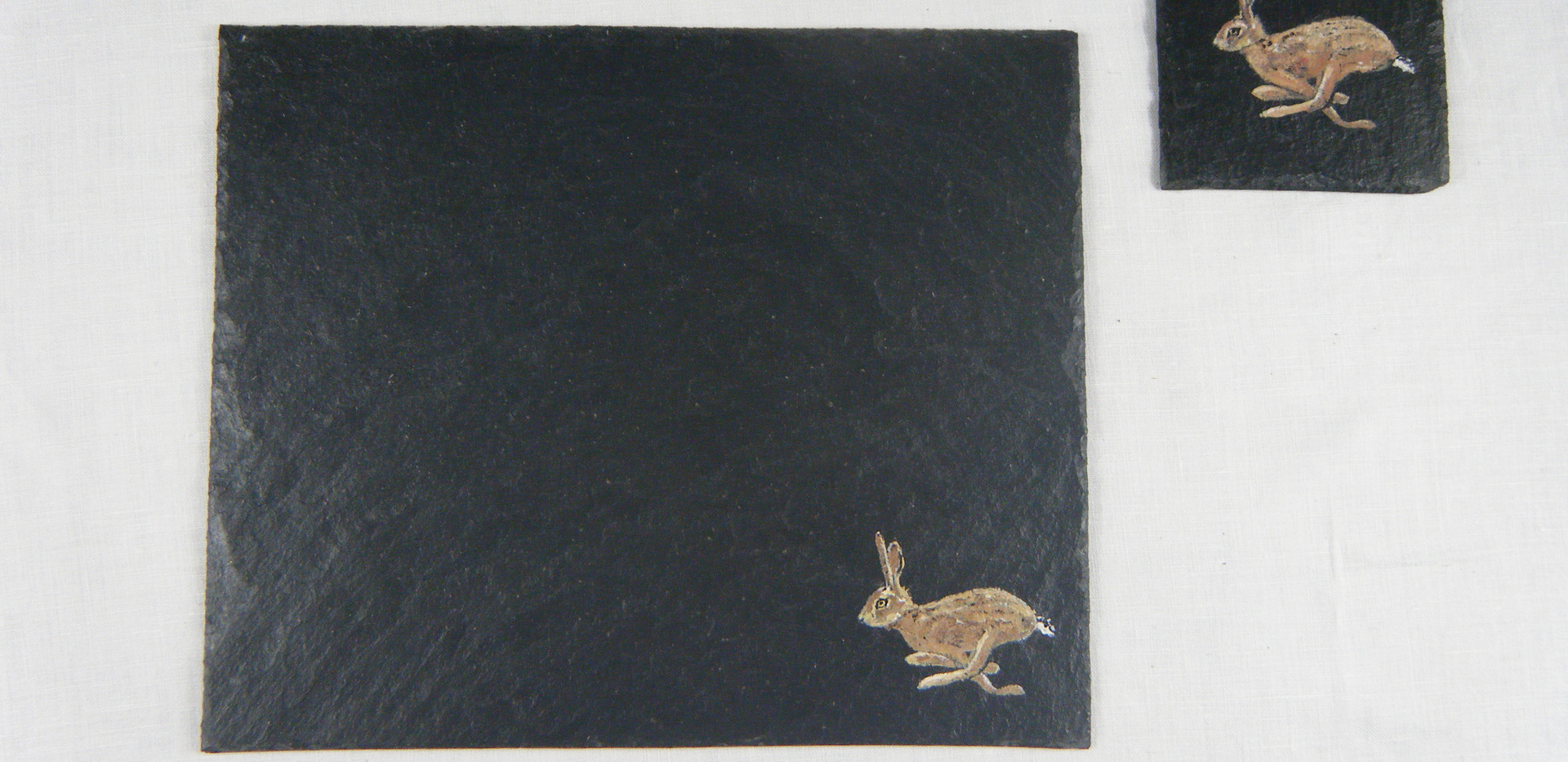 Slate placemat with hare design