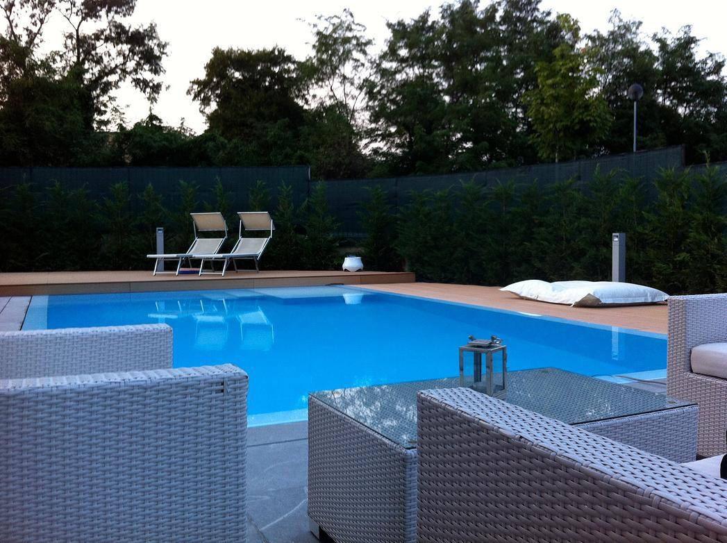 piscina acqua legno pietra