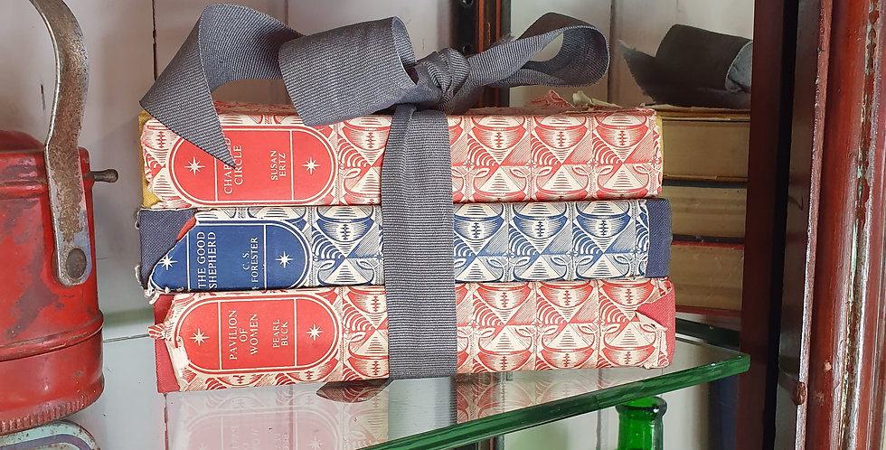 Vintage stack of books for display coloured