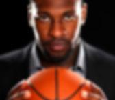 Tarik-in-suitholding-basketball.jpg