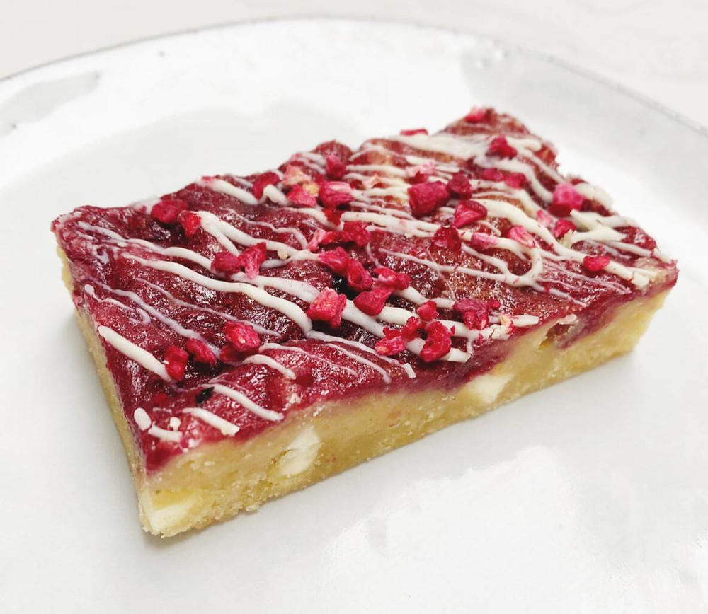 Raspberries and white chocolate blondie from Sheffield brownie baker, scrumptious by Lucy.