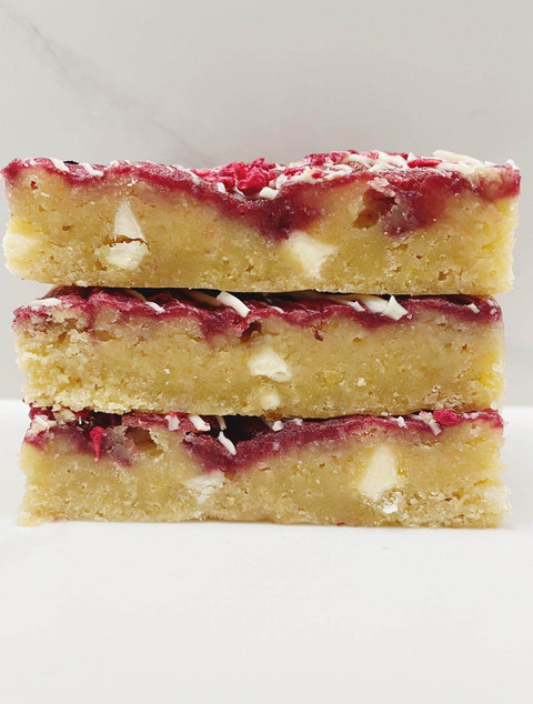 A stack of Raspberry and White Chocolate blondies