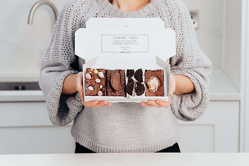A beautiful gift box of chocolate brownies for easter with all the Easter brownie flavours of creme egg brownie, mini easter egg brownie, chocolate orange brownie, and an Oreo Brownie