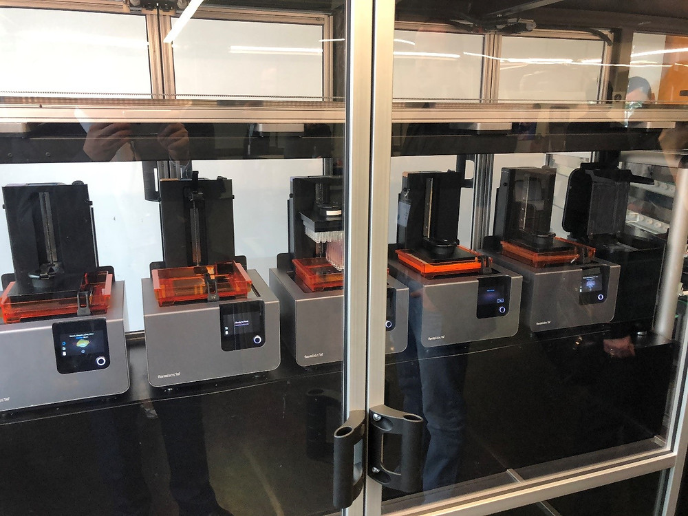 A picture of the FormCell system with several Form2 printers running inside of it.