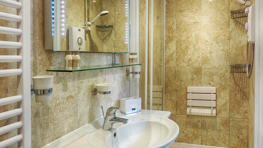 Bathroom at Woodbine Cottage at Bourton-on-the-Water, Cotswolds Holidays