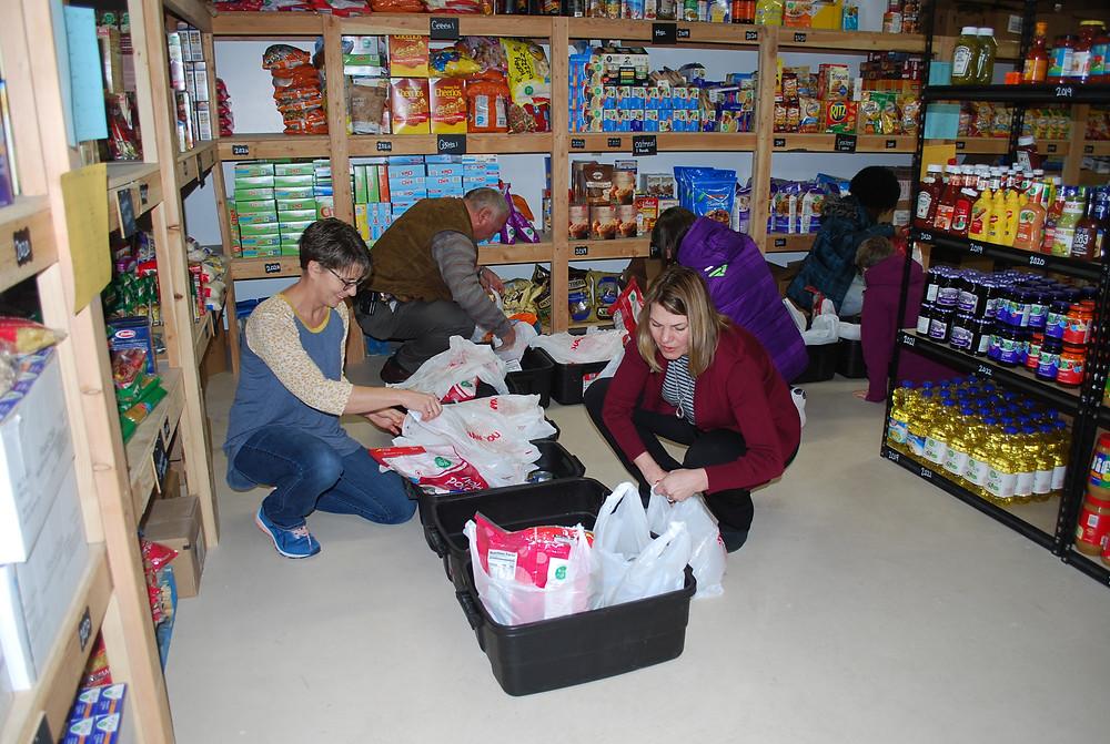 packing food boxes at Afton Food Pantry