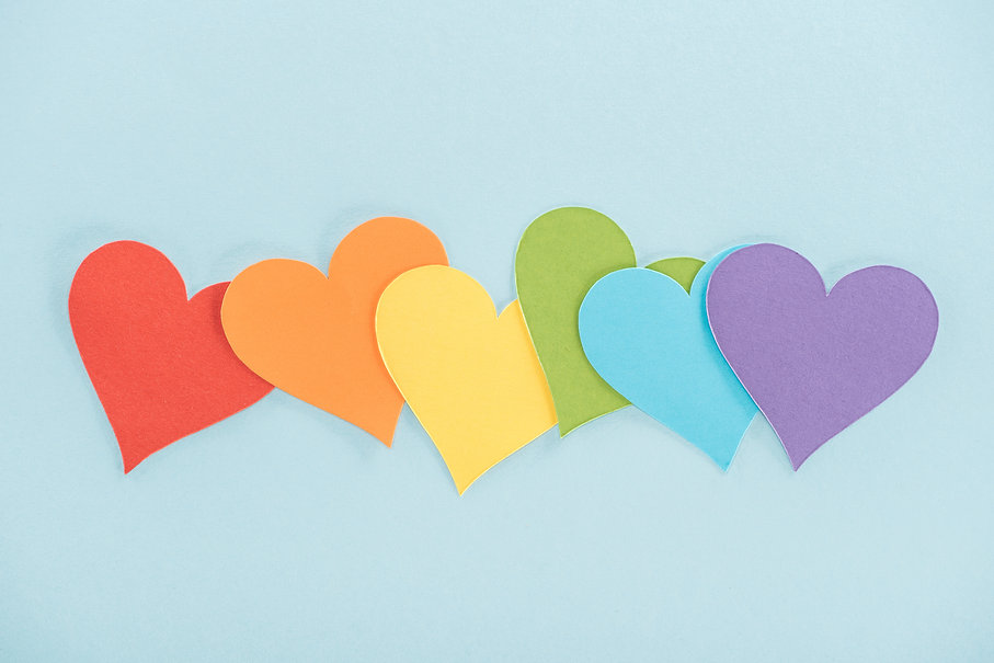 rainbow-colored-paper-hearts-on-blue-bac