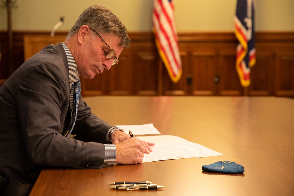 Governor signing document