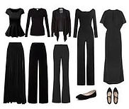 Multiple black shirts, sweaters, skirs, pants, dresses, and shoes.