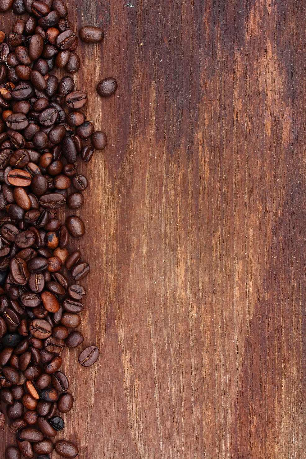 Coffee%20beans%20on%20wood%20background_