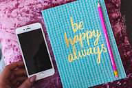 kaboompics_Blue notebook with a pink iPh