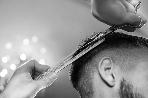 Men's hairstyling and haircutting in a b