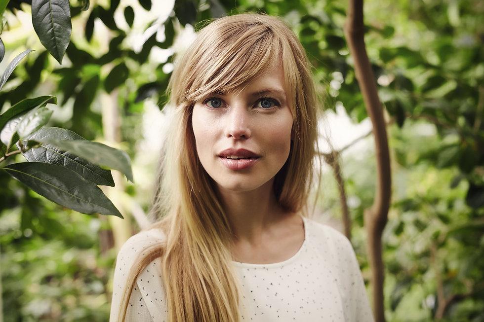 Stunning blue eyed blond woman in garden