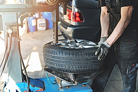 car%20mechanic%20changing%20tire%20on%20