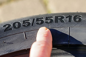 Side view of tire with tire width, heigh