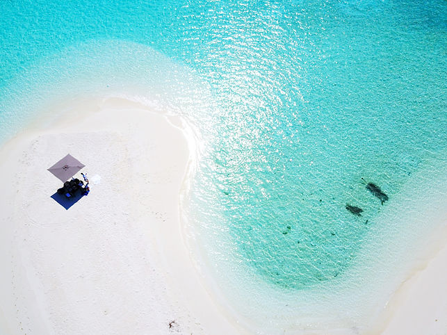 Drone view of picnic spot on an uninhabited island in the Maldives