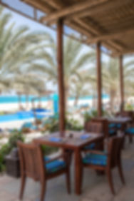 The outdoor dining deck at Olio, Al Yamm's mediterranean restaurant