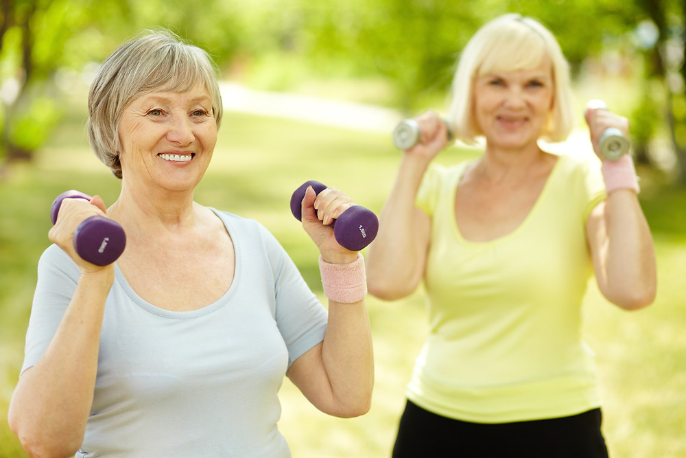 Senior women exercising with dumbbells