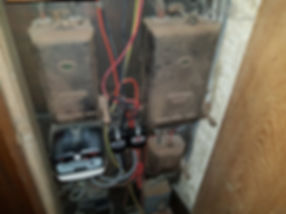 Photo of aincient cast iron main isolator with asbestos innards (not touched)