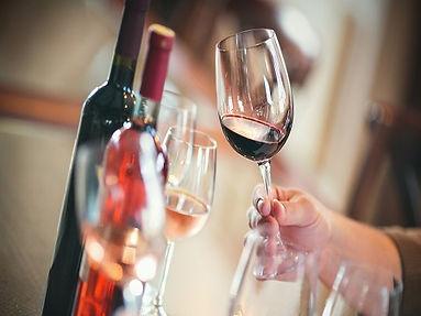 Raised glasses of wine