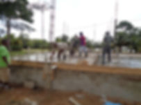 Home builders laying foundation of home