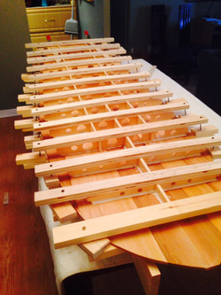 clamping wooden surfboard