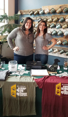 Board members Anne & Karolyn man the Oliver's table.