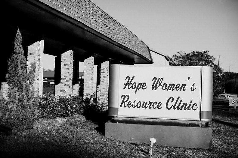 The front of the Hope Women's Resource Clinic building with sign.