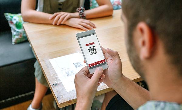man-scanning-restaurant-menu-qr-code-D4EJH78.jpg