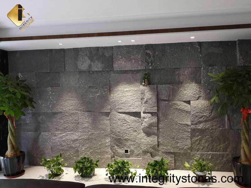 Living Room with Grey Stone Skin Feature Wall and Green Plants