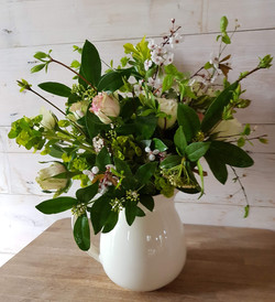 Flower filled vintage jugs from £45.  A selection of vintage jugs are available and can be filled wi