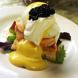 Butter Poached Lobster on Rye Toast and a poached egg hollandaise