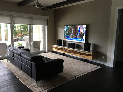 entertainment living room. The custom home entertainment center houses the musicBox 6 music server and  power amplifier DIY multi room audio installation at Krinker Residence
