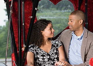 Couple sat in horse drawn carriage.jpg