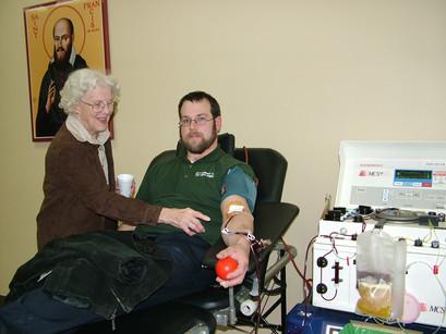 Doris helps a donor