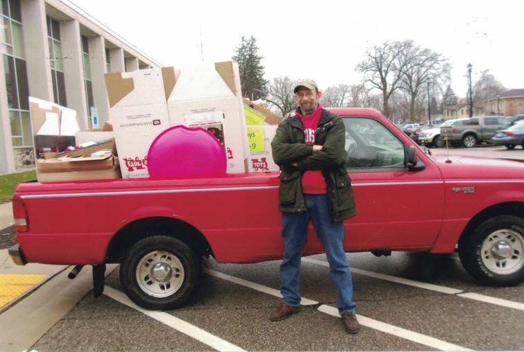 Volunteer picking up donations