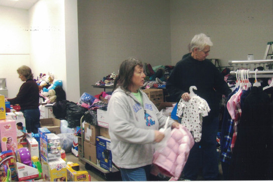 Patti and Linda sorting donations