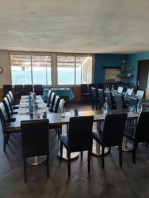 Salle de réception du restaurant Le Bottai avec vue mer