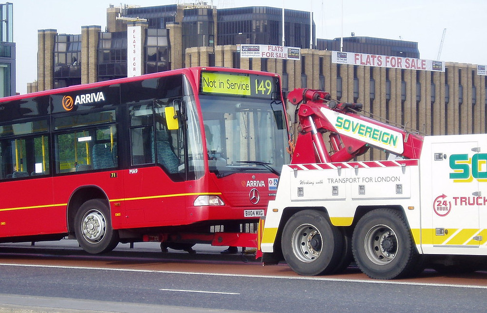 city bus being towed