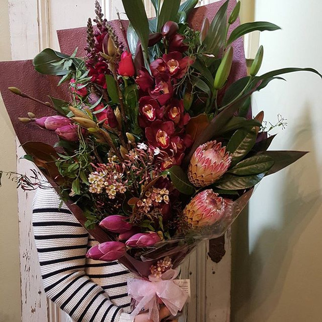 Orchids and protea flower delivery