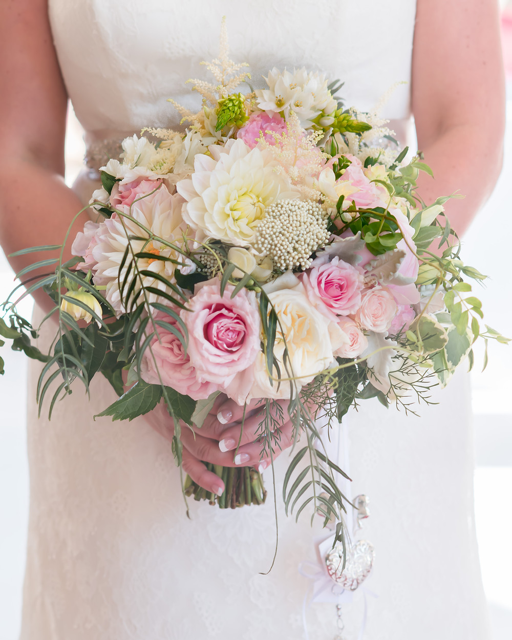 This spectacular wedding bouquet, made up of white dahlia's, pin k & white David Austin roses, Jasmine, Astible, rice flower and silver suede, was perfect for a beautiful sunny day in Melbournes CBD.