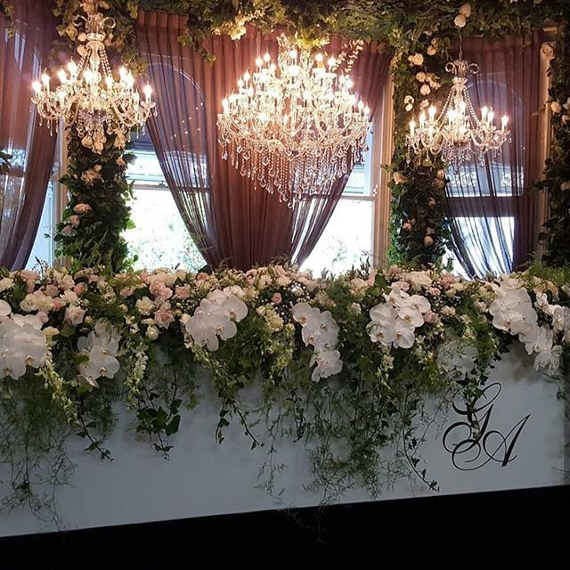 All white bridal table flowers