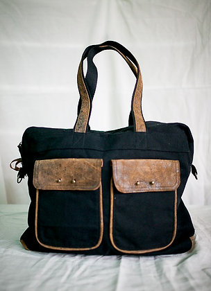 filipiNomad weekender in black and distressed tan