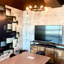 Feature Concrete walls designed by Janat Office Fit Out in Dubai